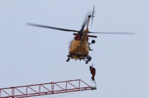 A search and rescue helicopter rescues a crane operator during a fire in downtown Kingston, Ont. Dec. 17.